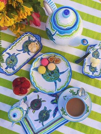 Hamilton, Bermuda: Hand painted turtle ceramics with matching linens.