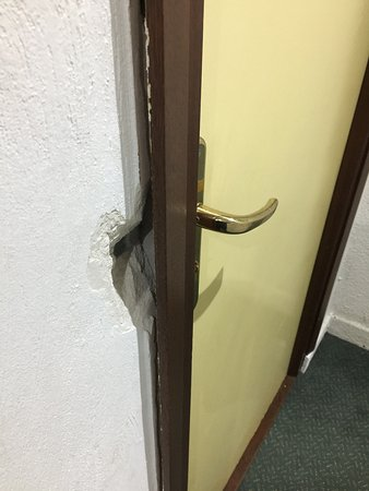 Chalet Hotel Moris: A typical door and frame in state of disrepair and in dire need of replacement