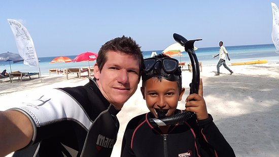 Divine Diving, Yoga & Dive Center: Me and my son snorkeling for the first time.