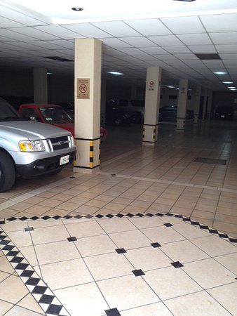 Note the clean tile floor in the inside parking area of the Hotel Casino Plaza.