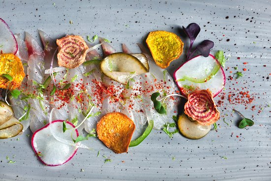 Morrison House, Autograph Collection: Snapper Crudo sliced radish, dill, pickled cucumber, jalapeno, beet chips, spring onions, espele