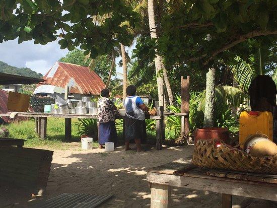 Denarau Island, Fiyi: Ladies are preparing the catch. It's an enlightening view into village life