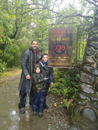 A 6 and a 10 year old finishing the Milford Track