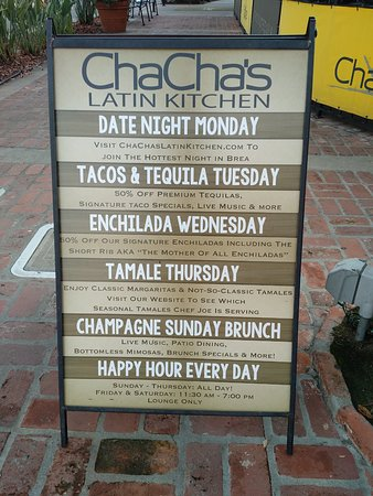 Promotional sign outside Cha Cha's Latin Kitchen in Brea, CA