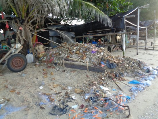 Phe, Thailand: Garbage outside fisherman's hut