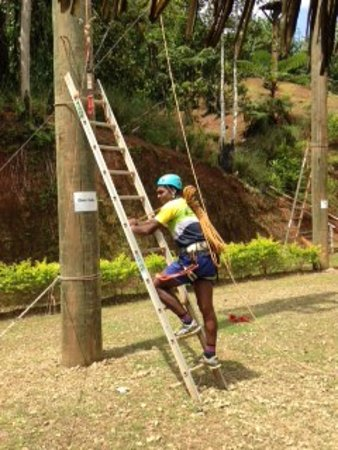 Kila Eco Adventure Park: Instructor Mika preparing to go up the Giant Swing