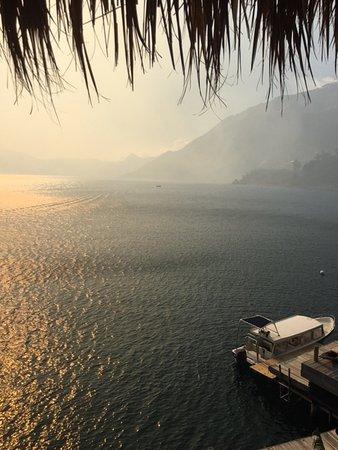 Laguna Lodge Eco-Resort & Nature Reserve: View from hotel balcony showing smoke