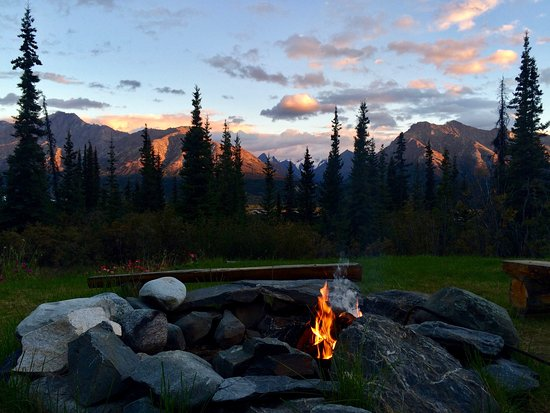 Glacier View, AK: Gather around the fire pit in the evening and watch the alpenglow turn colors on the mountains