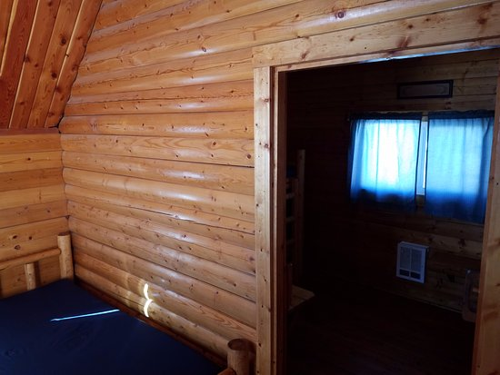 Laramie, WY: Entrance looking into second room with 2 sets of bunk beds
