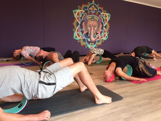 Swakopmund, Namibia: Students using the Dharma wheel for backbends in the Yin Yoga class.