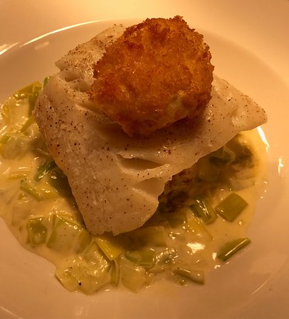 Bearsted, UK: Baked fillet of smoked haddock served on mustard mash with creamed leeks and a crispy poached eg