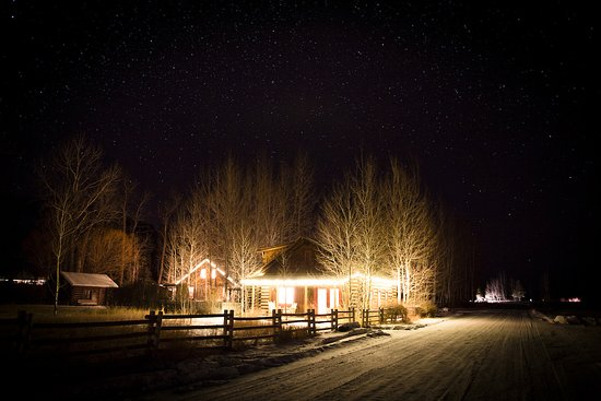 Philipsburg, MT: Eagles Perch and River House lit up with lights and starlight during the winter holidays.