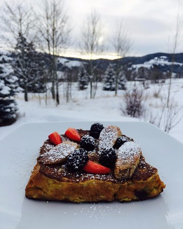 Philipsburg, MT: Panettone French toast served with caramelized bananas, strawberries and blackberries.