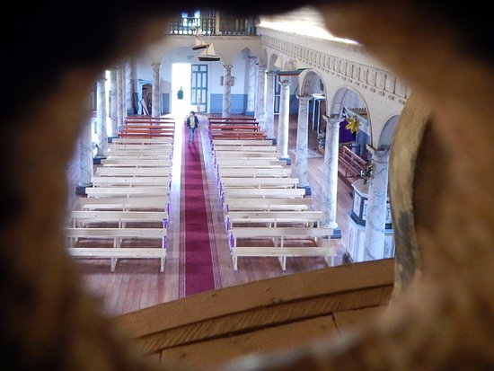 Castro, Chile: Spy hole from above the alter