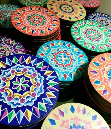 The Costa Rica Coffee Experience: Celebrating the colors and traditions of Costa Rica. Coasters with traditional art cart designs.