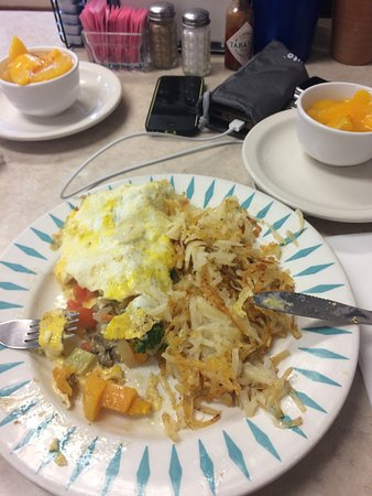 Milton Freewater, OR: half-eaten vegetable omelette with hashbrowns