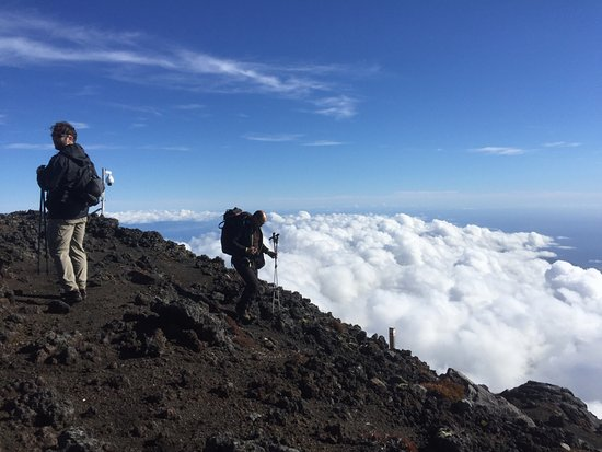 Madalena, Portugal: Guide Marcos above the clouds on the descent after a successful summit of Mt. Pico