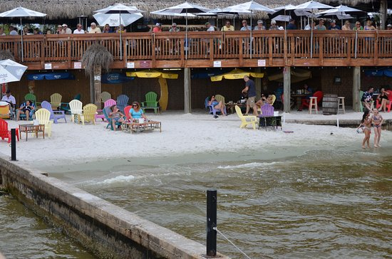 Cape Coral, FL: Small section of beach attached to restaurant.