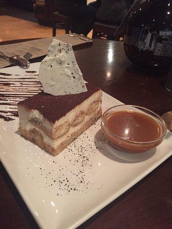 Costa Mesa, CA: Tiramisu with unused, and unneeded, caramel sauce.