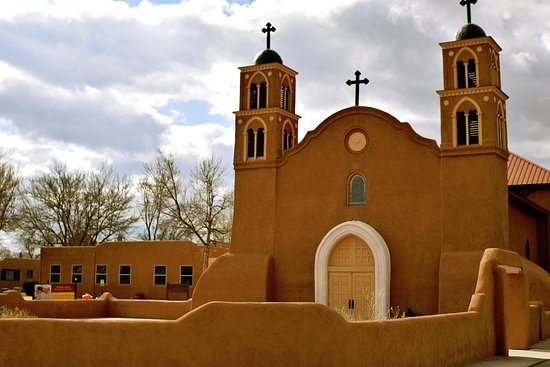 Socorro, NM: San Miguel Mission front, showing courtyard and side buildings.