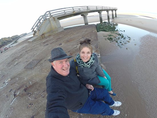 Musée de Normandie : Dad and I sitting on the Washed Up Barge on Omaha Beach