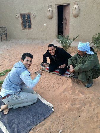 sitting around the campfire in the desert picture of moroccan