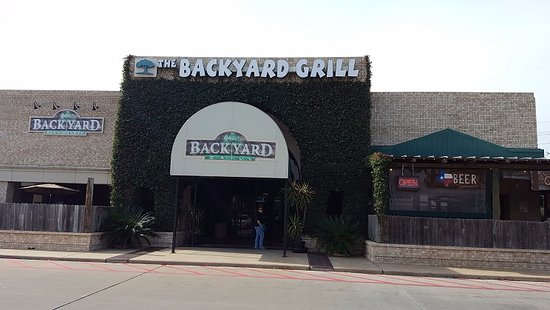 The Backyard Grill Houston entrance- it's in the corner of a strip mall - picture of the