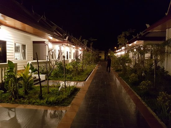 The rows of units and their gardens looking towards the pool area