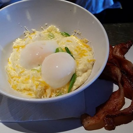 Livingston, MT: Poached Eggs and house made Cheesy Grits, with a side of local bacon.