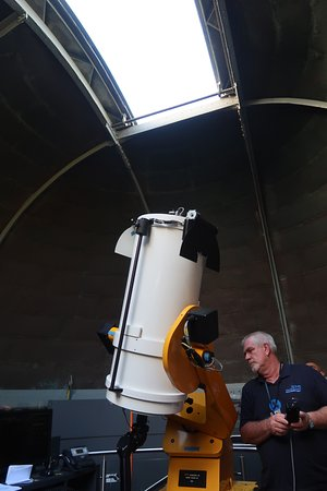 Sydney Observatory: Les adjusting the telescope in the East Dome