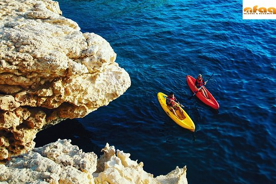 Enjoy the scenic beauty of Oman's coastline over the pristine waters