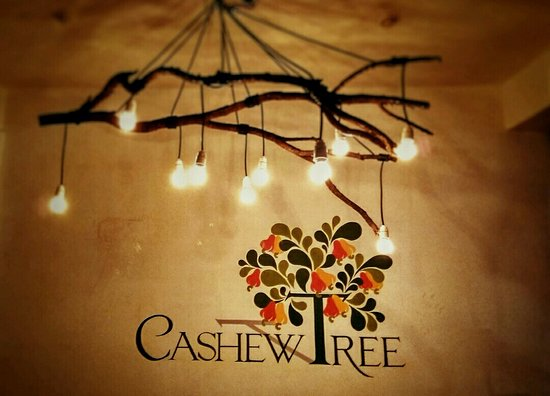 Our Logo And A Lovely Tree Branch Chandelier In The Main Dining Area