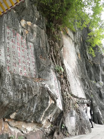 Zhaoqing, China: Poetry chiseled on limestone walls.