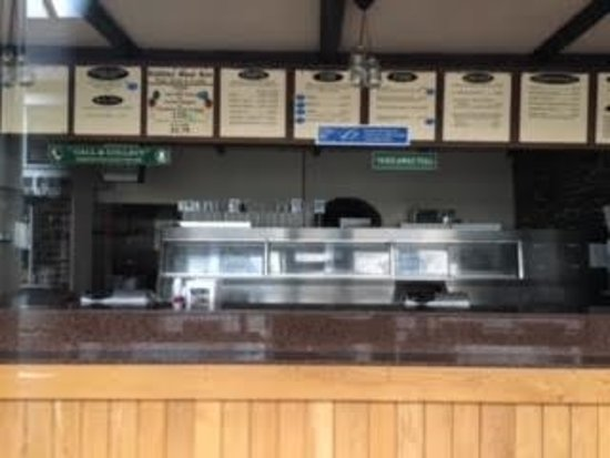 Lampeter, UK: Lloyds Fish and Chip Shop - the large take-away service section inside Lloyds