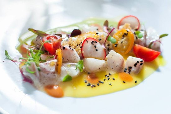 Shows a small gourmet dish from Caviar and Bull restaurant