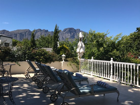 The Last Word Franschhoek: Outside first floor area overlooking the pool on the ground floor