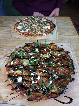 Voodoo Priestess pizza in the foreground - Angry Polish wife