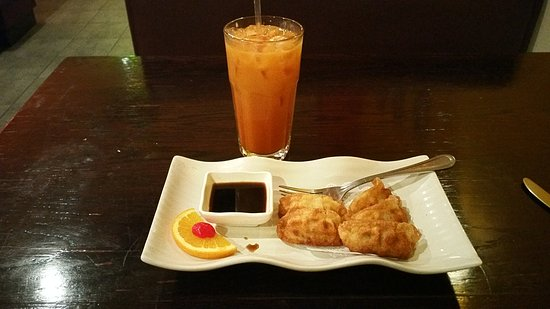 Twinsburg, OH: Thai iced tea and fried pork dumplings! I ate one prior to picture. Delicious!