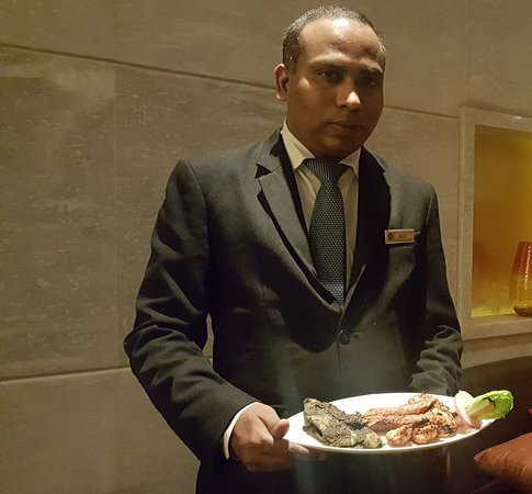 Beyond Indus: Restaurant manager with Kebab Platter