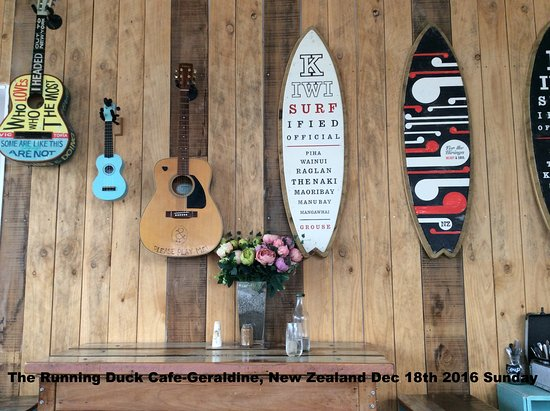 Geraldine, New Zealand: decor on wall-they invite you to tryat the guitar