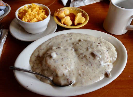 Tiffany's: HALF ORDER OF SAUSAGE GRAVY ON BISCUITS AND SIDE ORDER OF CHEESY GRITS.