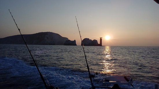 Hermit Charters: Sunrise over the needles.