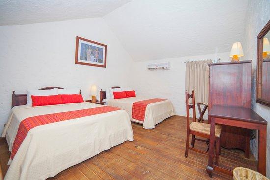 Hotel Villablanca Huatulco : Entre armonia y bellos detalles, se crearon habitaciones para momentos inolvidables.