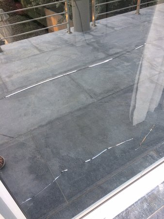 Sunset Beach, South Africa: another angle of smashed glass pane in lounge