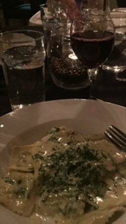 Rossland, Canada: House red wine with the goat cheese and arugula ravioli .