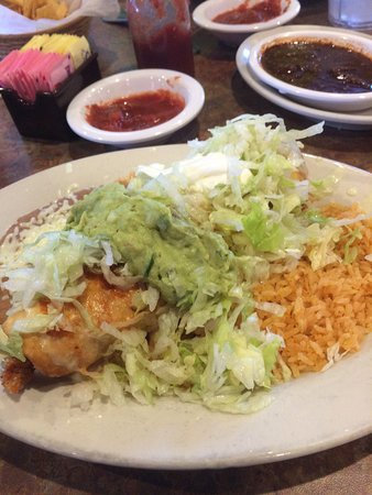 Photo of fried chimichanga with sour cream and guacamole on top from La Cocina in Mebane