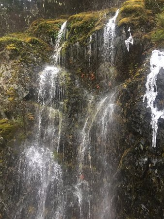 Late Winter Waterfalls out of the mountain at Horne Lake Caves Provincial Park, Qualicum Beach,