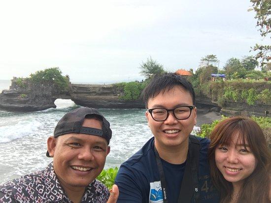 Bali Surya Tour - Private Tours: Tanah Lot. Photo of us and Suryanto