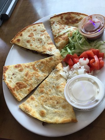Westland, MI: Chicken, and Cheese Quesadilla served with Lettuce, Tomato, Onion, Salsa and Sour Cream.