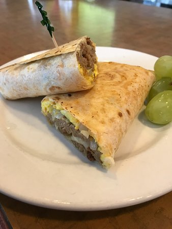 Westland, MI: Breakfast Burrito, with your choice of meat, onion, green pepper, scrambled eggs, Salsa & sour c